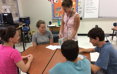 Miss. Ziegler works with Spanish Club students in the Innovation Lab at the High School