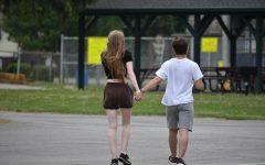 Julie Bizub, left, walks with her boyfriend at the Kaelys Kindness fundraiser walk on May 22, 2021 at Alden High School.